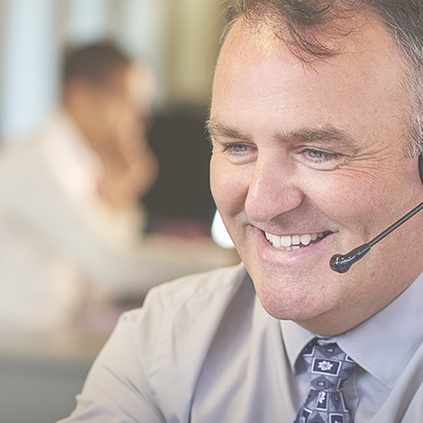 man talking on a headset in a call center